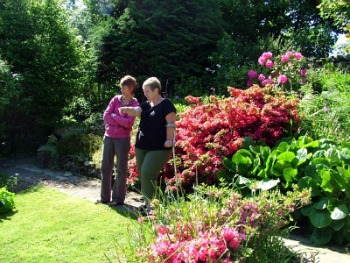 Wendy and Friend in Her Award Winning Garden