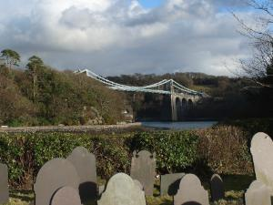 St Tysilio Church Island - Menai Straits, Anglesey.  Thomas Telford's Suspension Bridge in the Background
